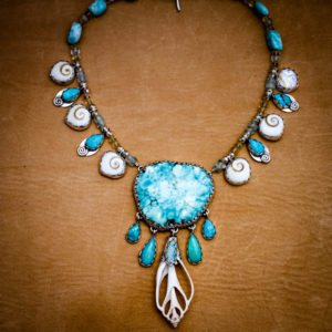 with turquoise, shells, chrysicholla and opal