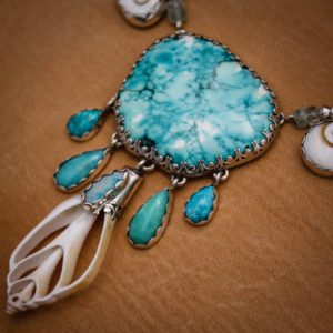 shells and turquoise together making potent water prayer